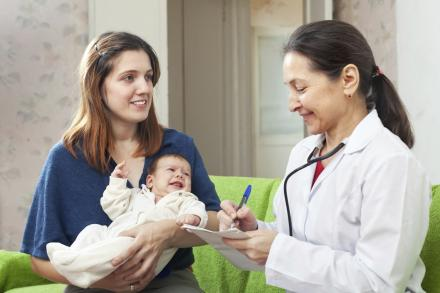Doctor with mom of newborn